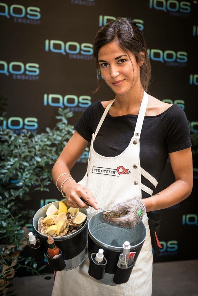 Oyster shucker girl in a oyster catering event