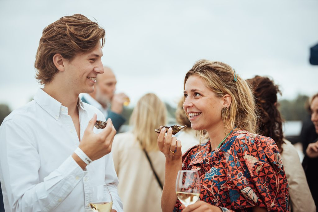 Couple enjoying Oysters from our oyster catering service